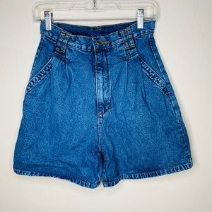 Vintage high waisted blue denim shorts.